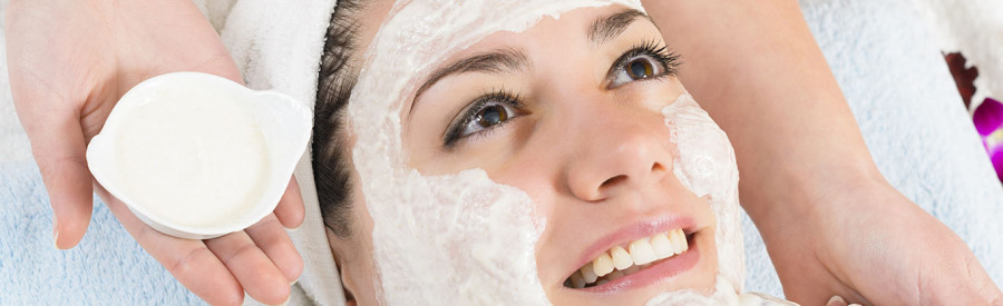 Woman-getting-facial-with-white-mask-on-face