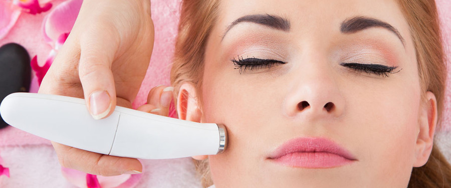 Woman-getting-microdermabrasion-on-facial-cheek-area